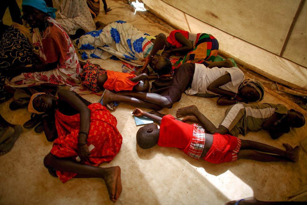 Sick children wait to be seen at the Doctors Without Borders clinic in Bentiu. Many children in the camp suffer from malaria and malnutrition.