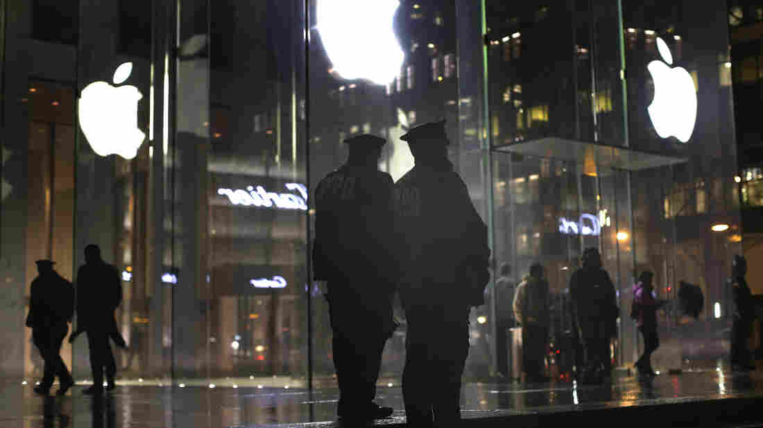New York police officers stand outside an Apple Store on Tuesday while monitoring a pro-encryption demonstration.