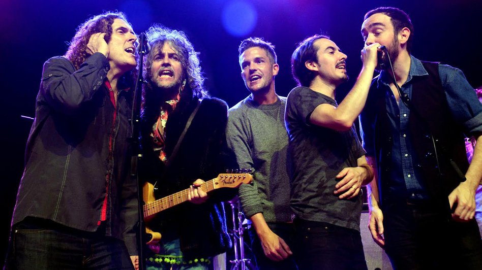 Dhani Harrison (second from right) joins Weird Al Yankovic, Wayne Coyne of The Flaming Lips, Brandon Flowers of The Killers and Jonathan Bates of Mellowdrone on stage at George Fest.