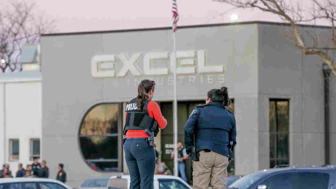 Police guard the front door of Excel Industries in Hesston, Kan., where a gunman killed three people and injured a dozen more on Thursday.
