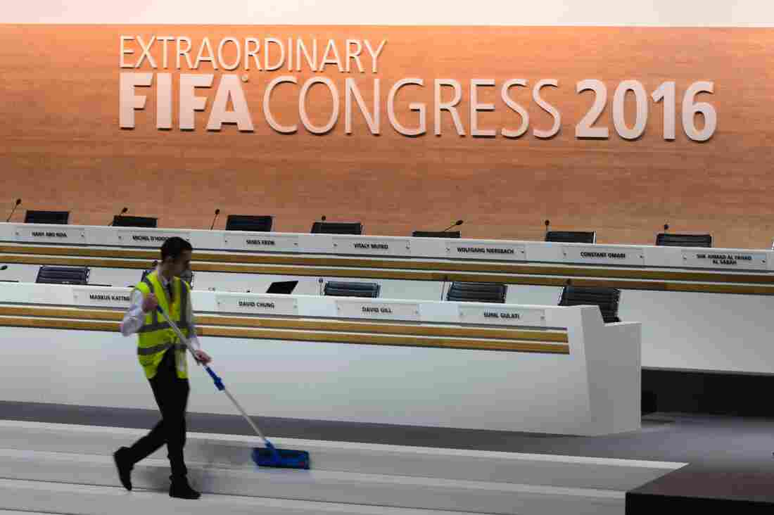 A worker cleans the stage during a break at the FIFA electoral congress on Friday in Zurich.