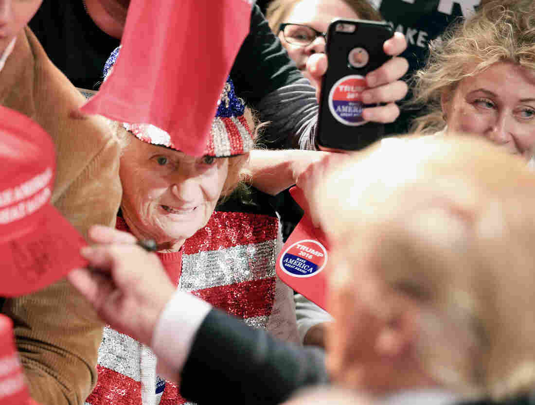 Republican presidential candidate Donald Trump signs autographs for fans at a rally in Fort Worth, Texas.