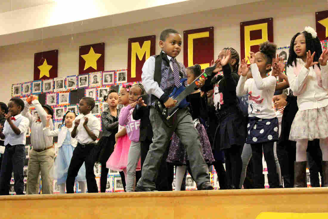 """First grade students rock out to """"Let's Go Crazy,"""" honoring their chosen black icon, singer-songwriter Prince."""