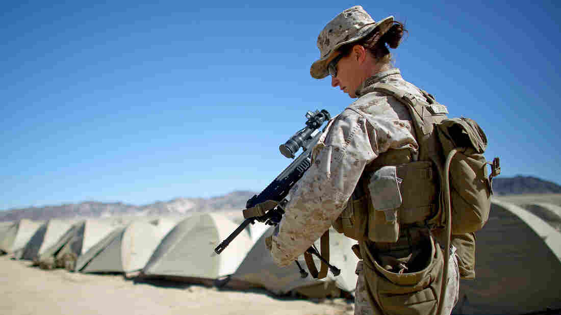 Sgt. Kelly Brown is seen at the Marine base at Twentynine Palms, Calif., during a training experiment in 2015 to determine whether women could serve in ground combat positions.