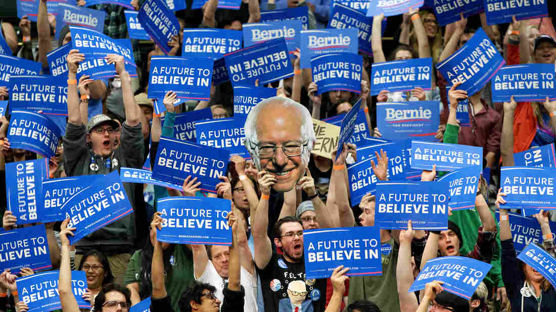 Supporters of Democratic presidential candidate Sen. Bernie Sanders cheer and hold up signs, including one of Sanders, during a campaign rally at Colorado State University Sunday.