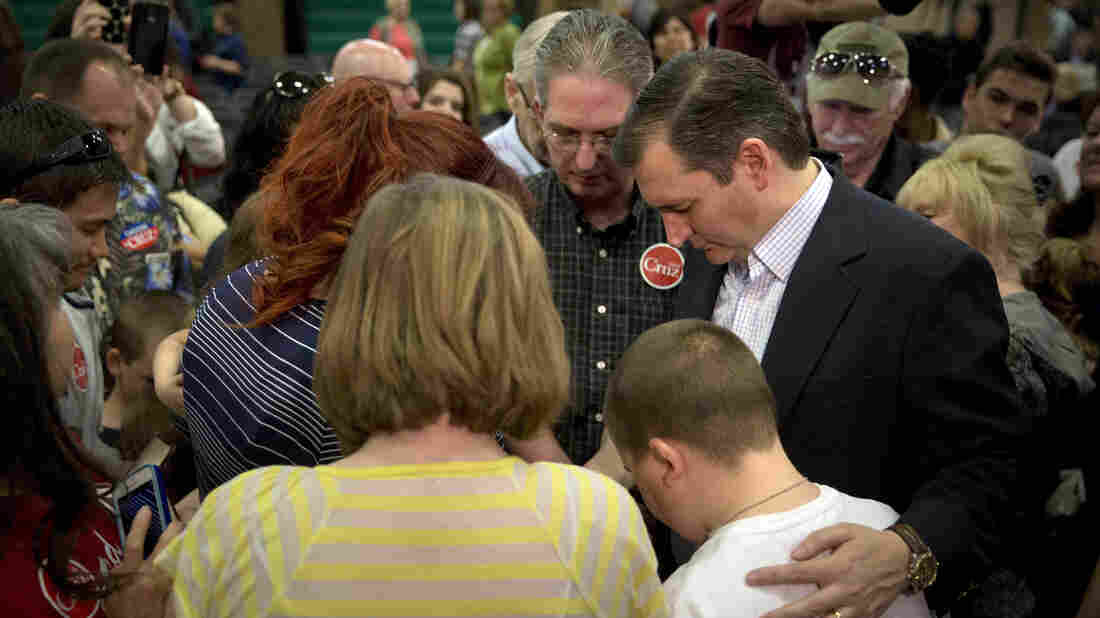 Sen. Ted Cruz, R-Texas, prays with a group of supporters after a rally earlier this month in Las Vegas.