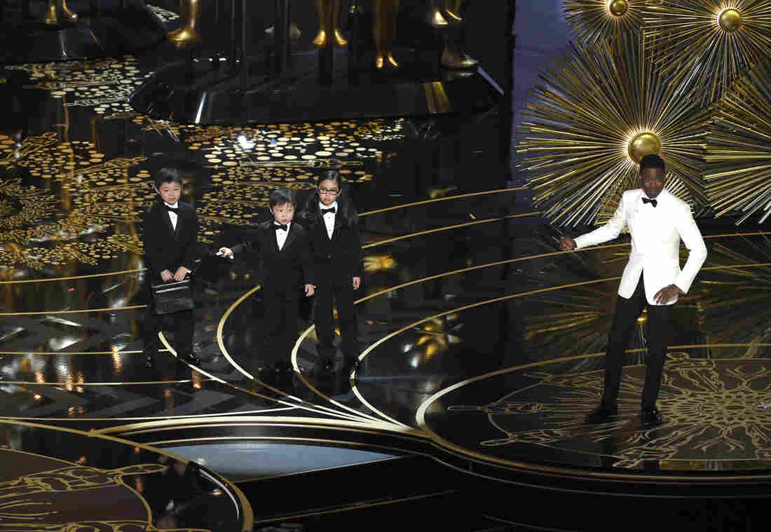 Host Chris Rock and children participate in a skit during the Oscars.