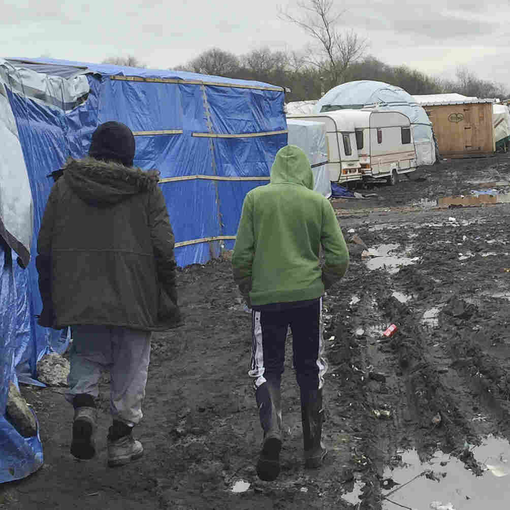 A Young Afghan Migrant Makes His Way In The Calais 'Jungle'