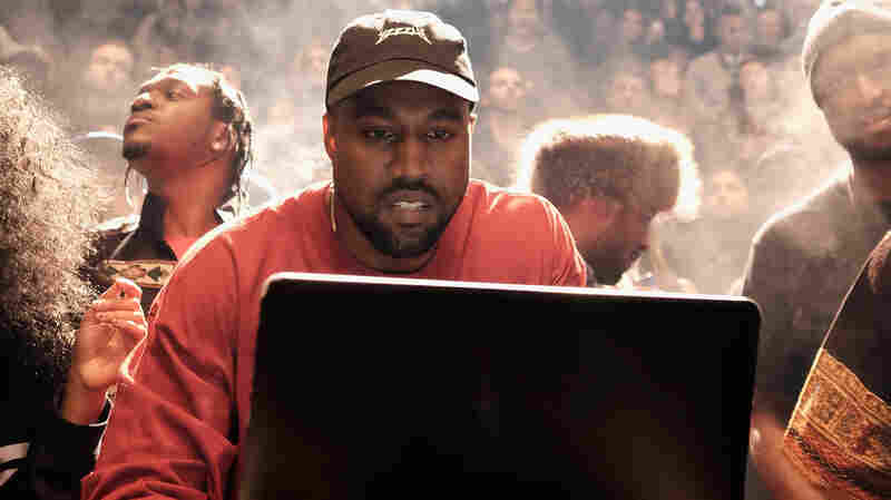 Kanye West at a laptop during his Yeezy Season 3 fashion show and album debut at Madison Square Garden in New York Feb. 11.