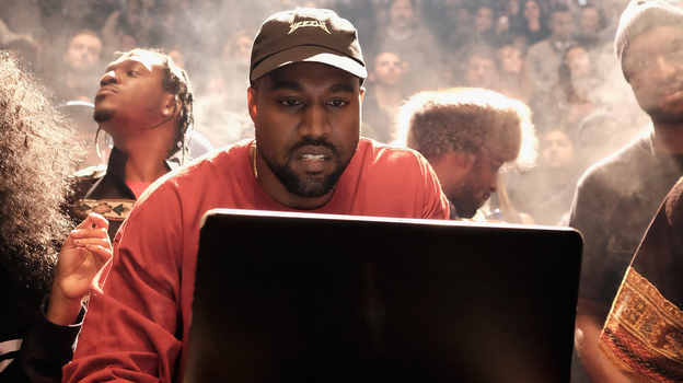 Kanye West at a laptop during his Yeezy Season 3 fashion show and album debut at Madison Square Garden in New York Feb. 11. (Getty Images)