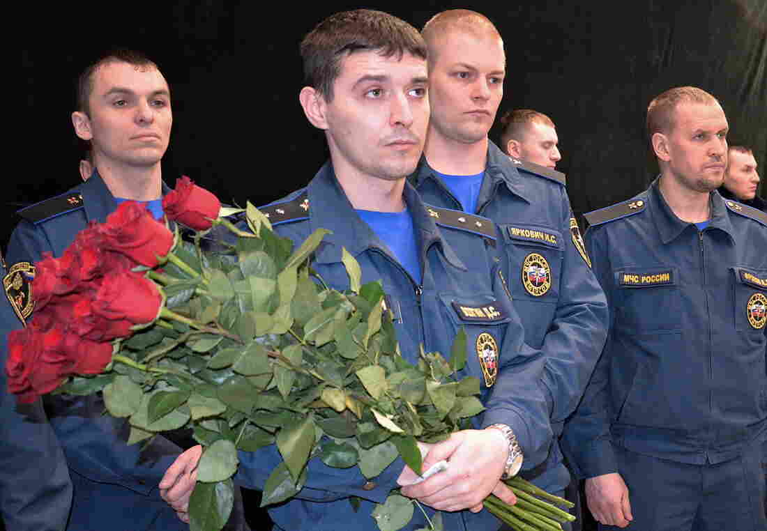 Members of Russia's Emergency Situations Ministry attend a ceremony for miners killed at the Severnaya coal mine in a town north of the Arctic Circle.