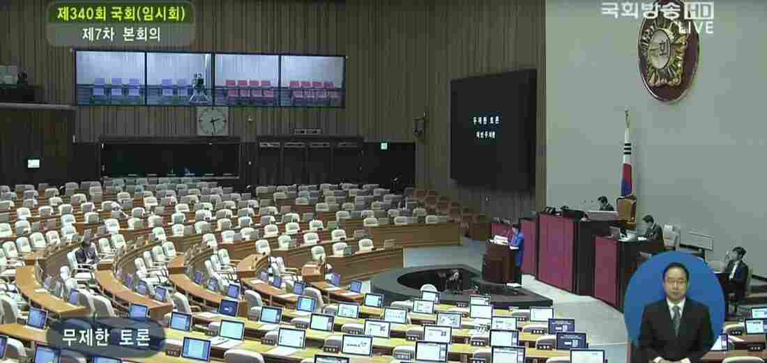 A member of the main opposition party in South Korea speaks past midnight and into Tuesday morning, marking the seventh day of a filibuster against a new surveillance bill.