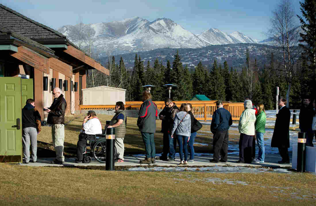 Republican voters line up outside a polling place in Anchorage, Alaska. The Republican caucus there was the last Super Tuesday contest, ending at midnight ET.