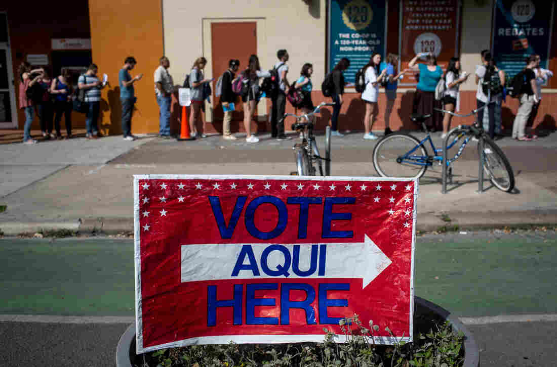 Voters wait in line to cast their Super Tuesday ballots at a polling station located at the University Co-op in Austin, Texas. The state has the most delegates up for grabs tonight.