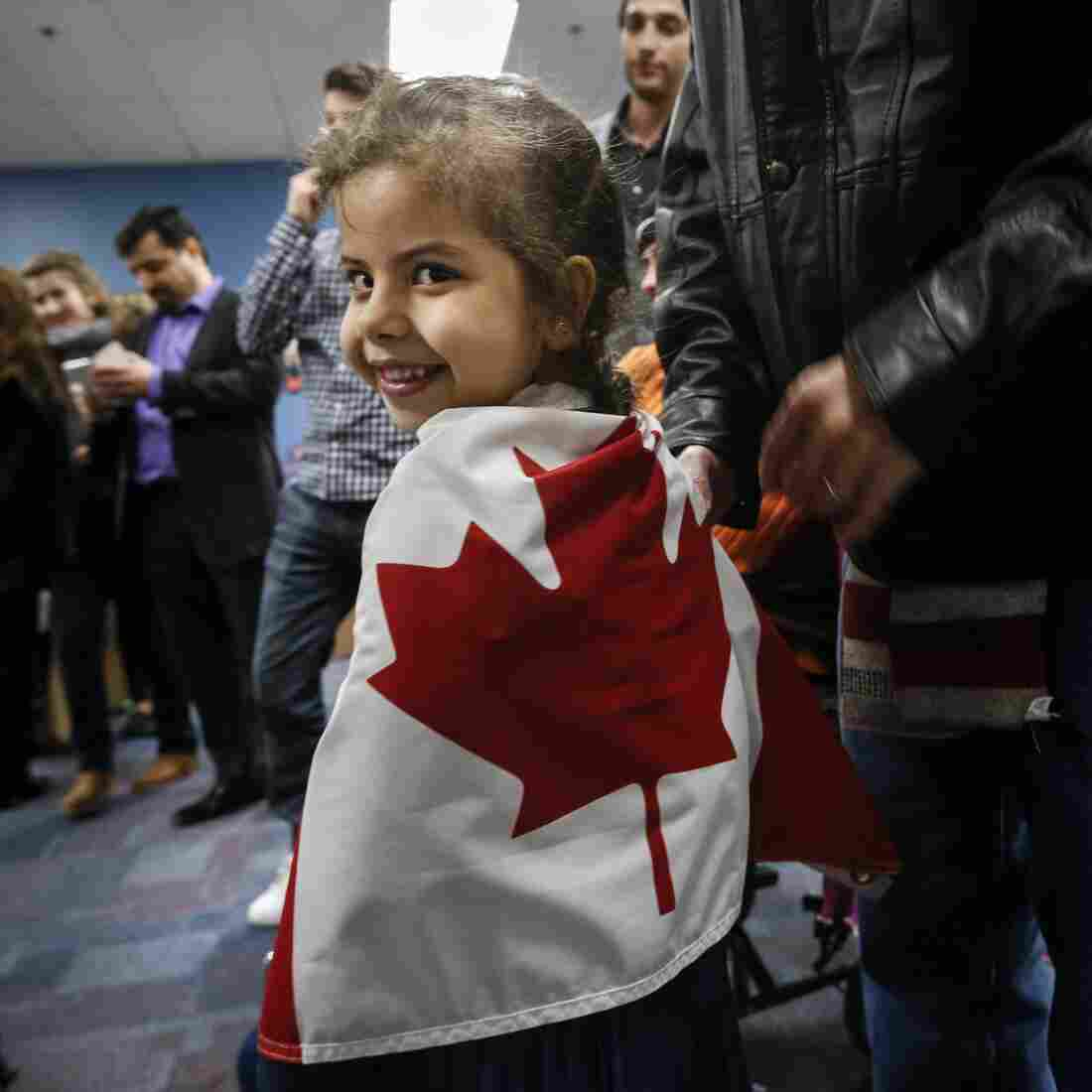 Reemas al-Abdullah, 5, wrapped herself in a Canadian flag before a dinner hosted by Friends of Syria at the Toronto Port Authority in December.