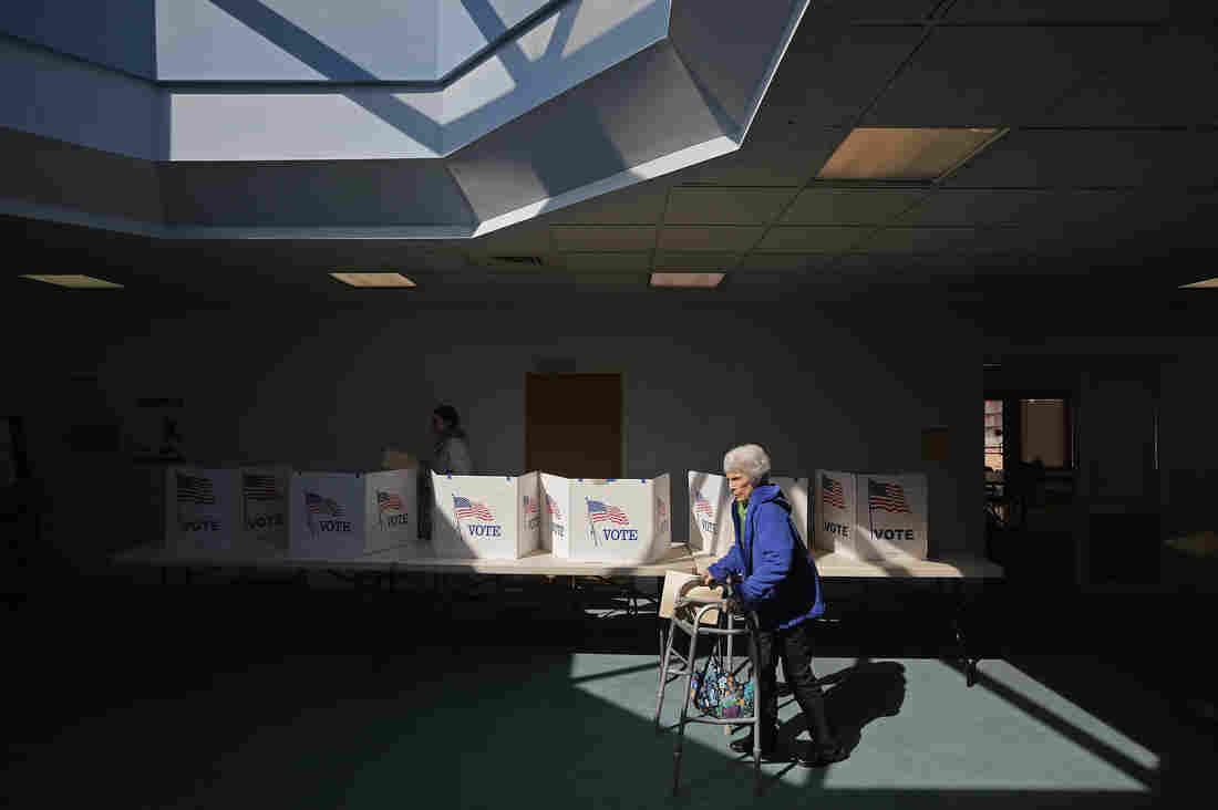 Primary voters cast their ballots Tuesday at Fairfax Circle Baptist Church in Fairfax, Va.