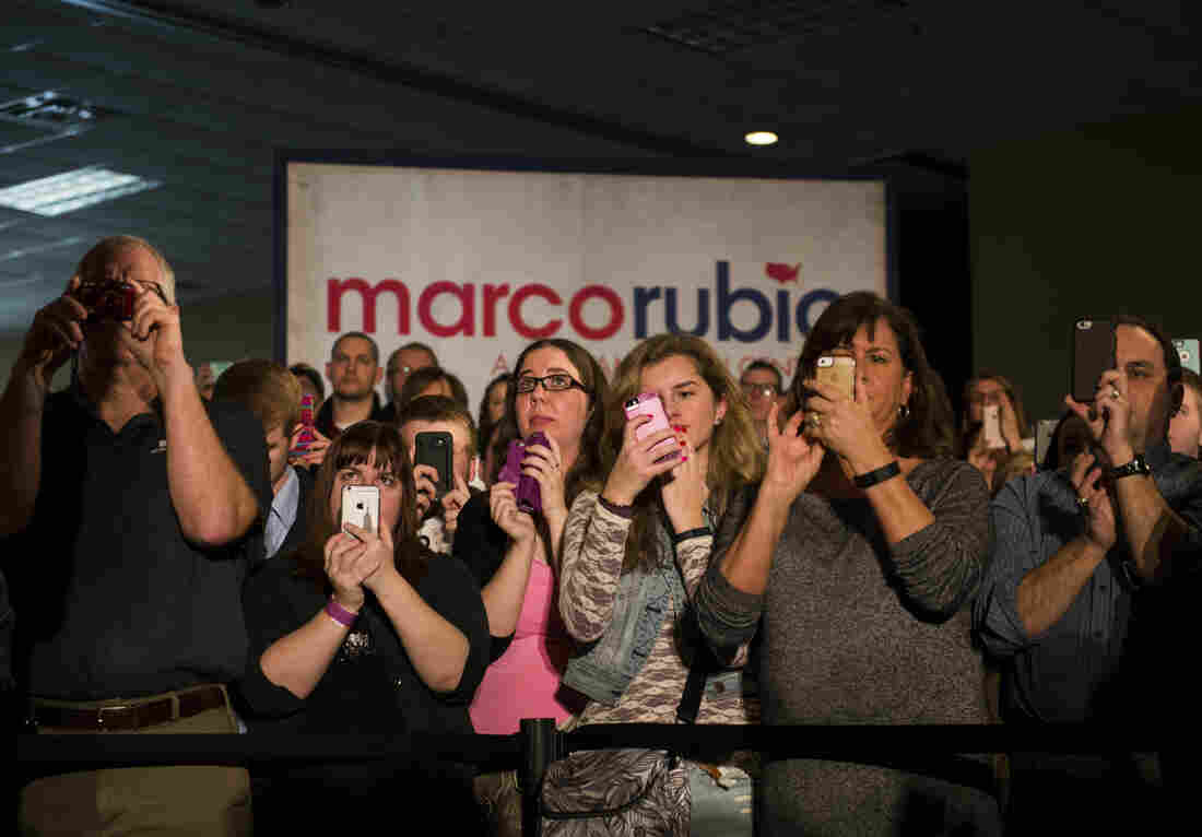Supporters of Republican presidential candidate. Marco Rubio photograph him as he speaks during a campaign rally at Courtyards of Andover Event Center in Andover, Minn.