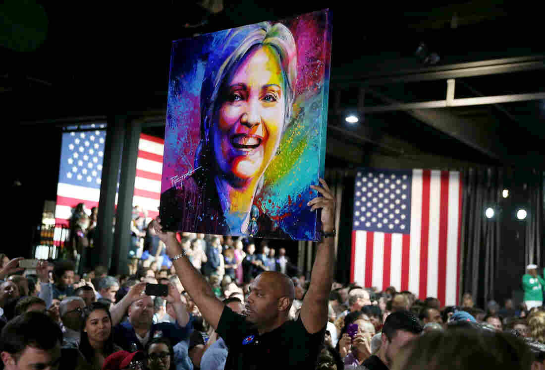 A portrait of Democratic presidential candidate Hillary Clinton is held up during her event at Stage One at Ice Palace Films Studios in Miami.