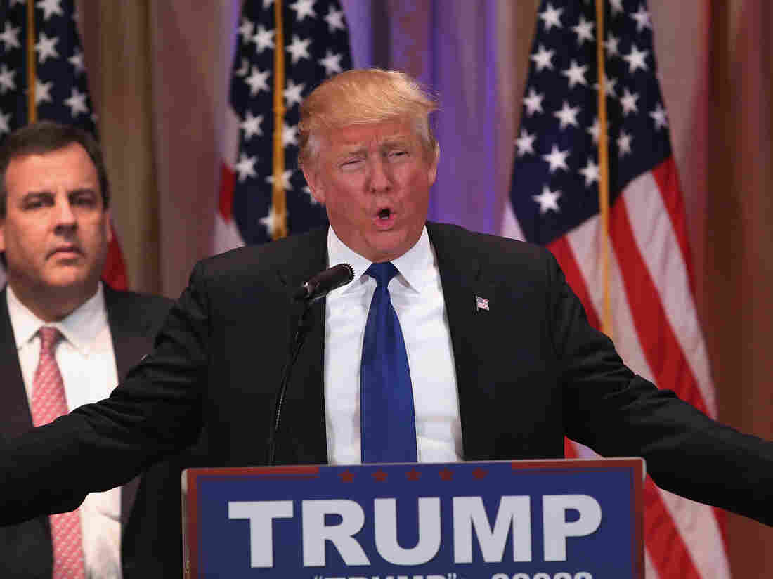 With New Jersey Gov. Chris Christie at his side, Republican presidential front-runner Donald Trump speaks to the media in Palm Beach, Fla., on Tuesday.