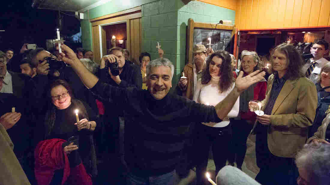 Ibrahim Parlak [center] at the Cafe Gulistan, his restaurant in Harbert, Mich., during a candlelight vigil on Dec. 23, 2015. An ethnic Kurd from Turkey, Parlak came to the U.S. in 1991 and received political asylum. But U.S. immigration authorities are now trying to deport him to Turkey, which says he fought against the state in the 1980s.