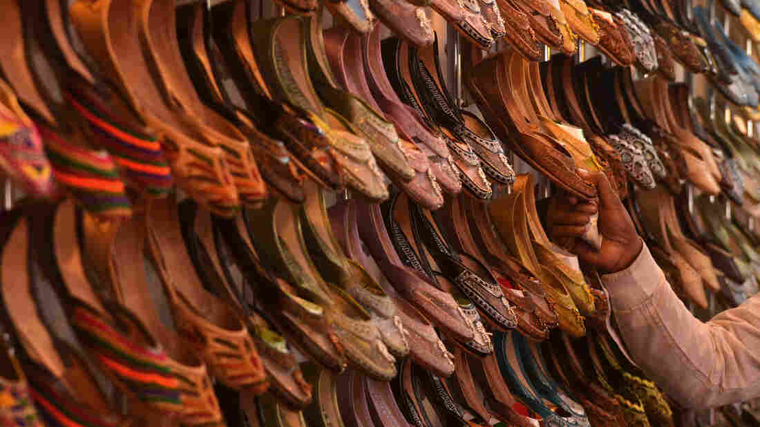 Traditional Punjabi shoes are displayed at a trade expo in Amritsar, India. The country's new budget will cut the taxes on materials used in heels and soles.