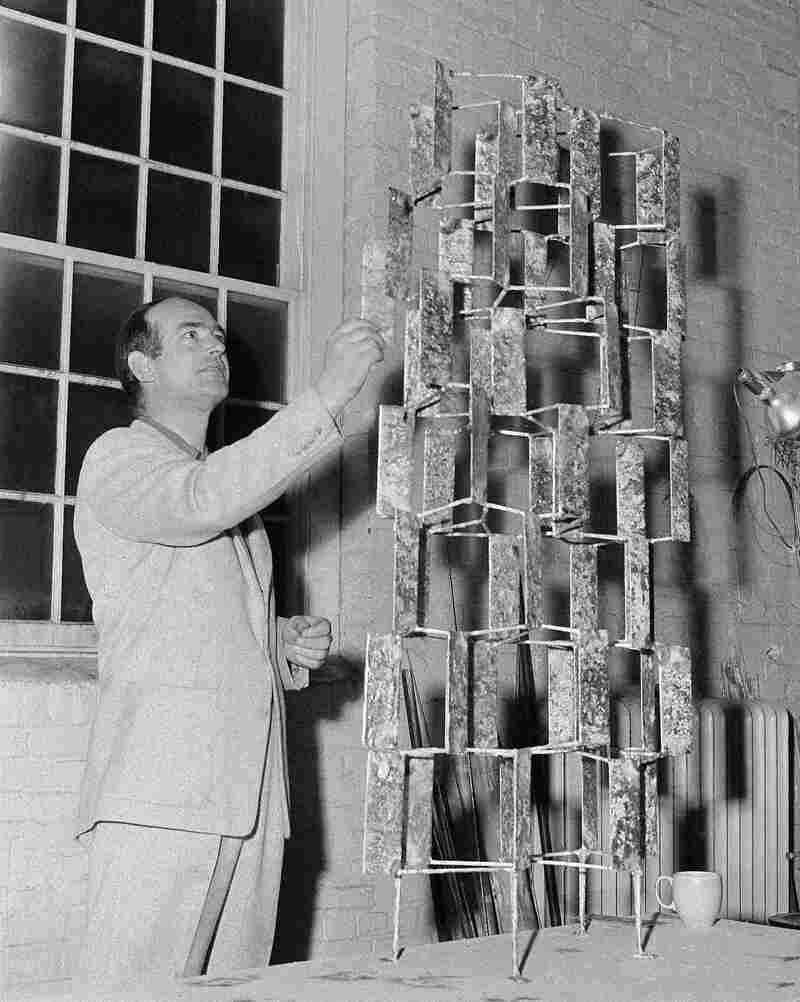 Bertoia looks at one of his art pieces at his studio in Barto, Pa., in May 1956.