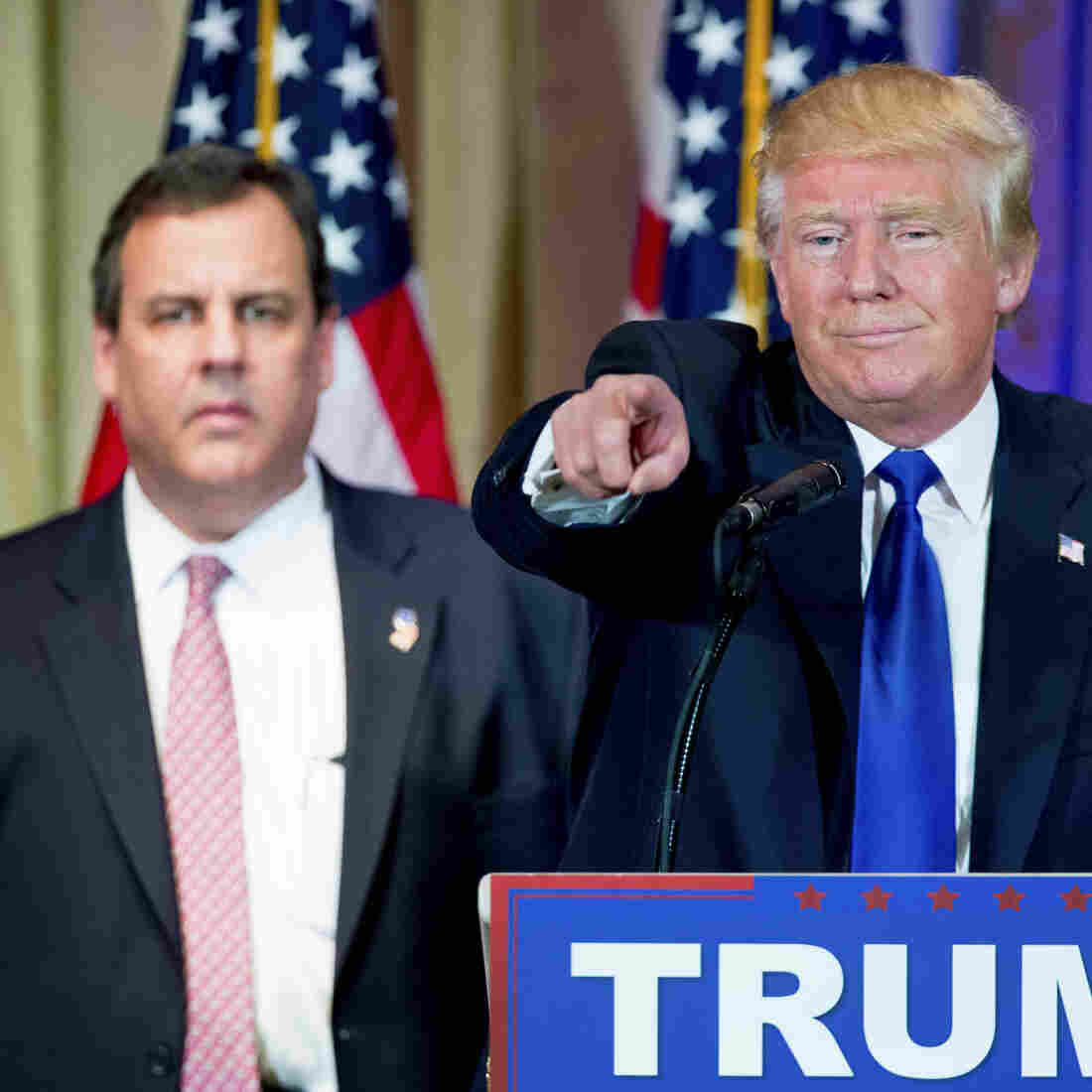 New Jersey Gov. Chris Christie looks on as Republican presidential candidate Donald Trump takes questions from members of the media during a news conference on Super Tuesday primary election night.