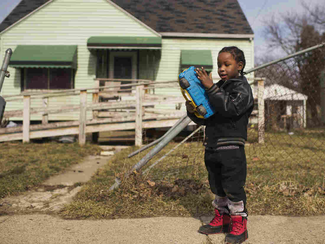 Davarious Griffin, 5, who has had elevated levels of lead detected in his blood, plays outside of his house in Flint, Mich., last month.