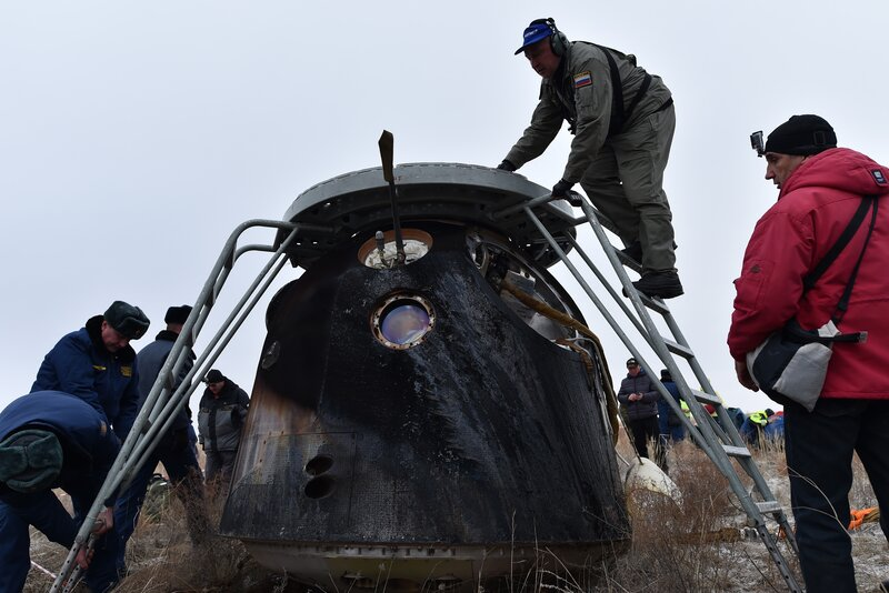 A search and rescue team works at the site where the capsule landed. (Kirill Kudryavtsev/AFP/Getty Images)