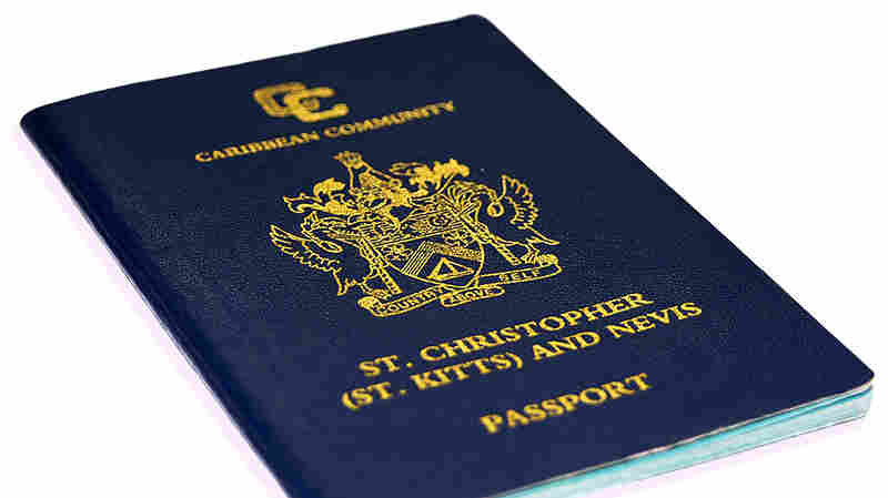 "A St. Kitts and Nevis passport. St. Kitts has a ""citizenship by investment"" program in which passports can be bought and sold."