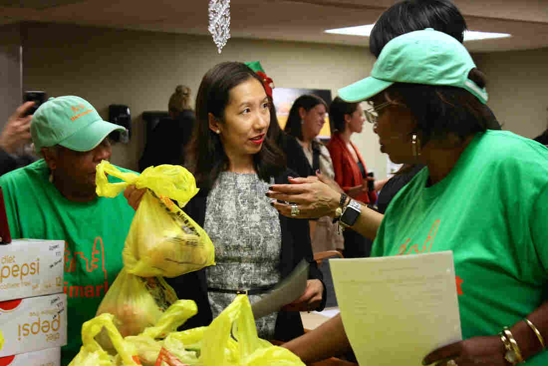 Dr. Leana Wen helps distribute groceries to seniors in a Baltimore neighborhood with few fresh food options.