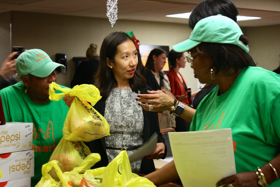 Dr. Leana Wen helps distribute groceries to seniors in a Baltimore neighborhood with few fresh food options. (Courtesy of Lizzy Unger/Baltimore City Health Department)