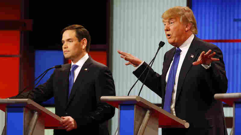 Donald Trump gestures Thursday as Sen. Marco Rubio, R-Fla., listens to Trump's response during a Republican presidential primary debate in Detroit.