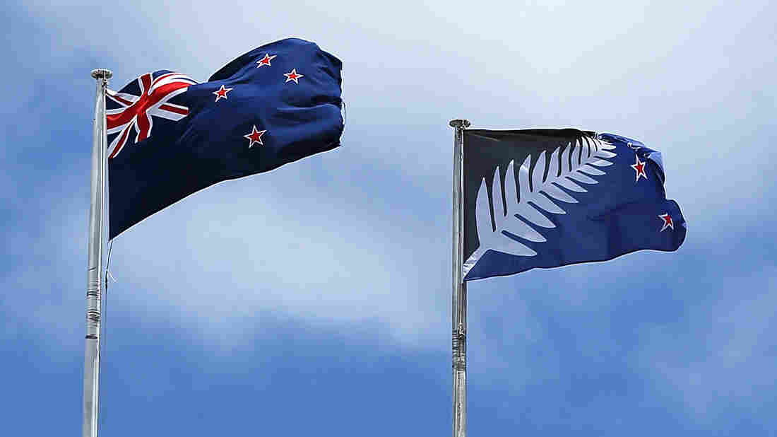 A photo from December shows the current New Zealand flag (left) and the alternative design currently up for a vote.