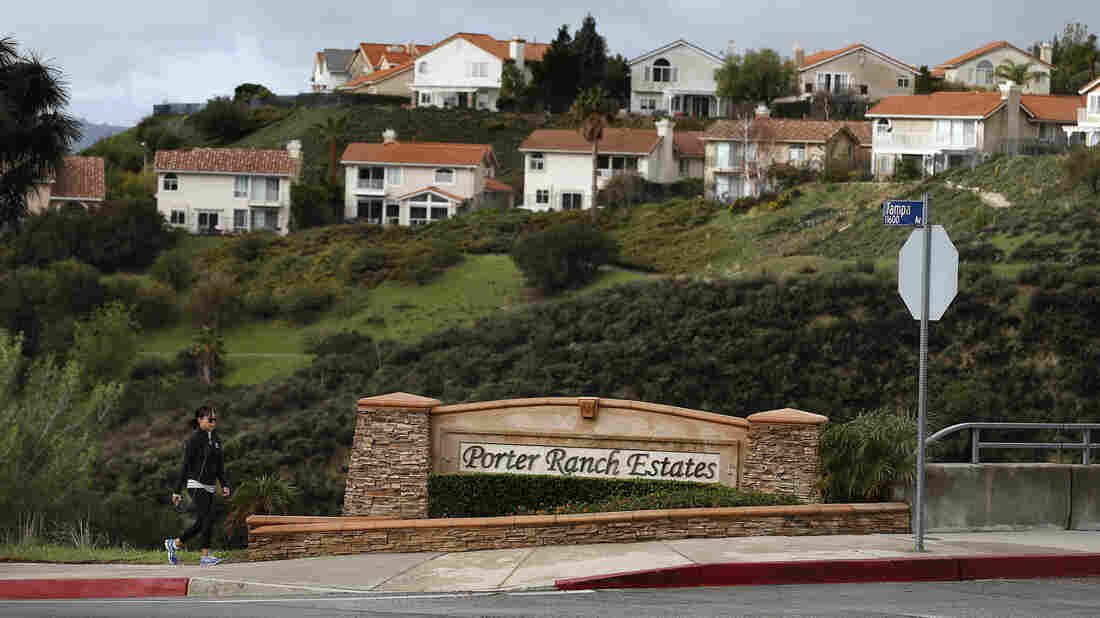 A woman walks to her home in Porter Ranch, Calif., last month, after state regulatory officials announced that SoCalGas Co.'s leaking well had finally been plugged.