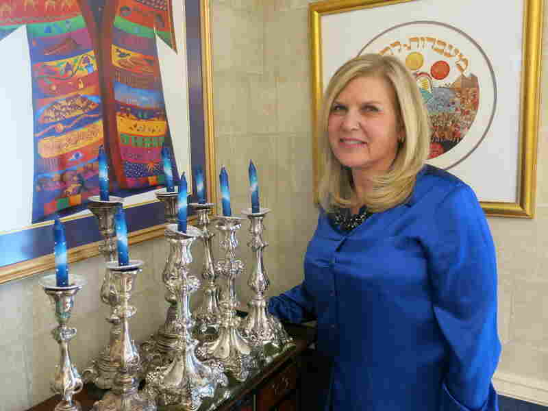 Margie Robinow, an observant Jew who lives in Overland Park, Kan., lights Sabbath candles every Friday for herself, her husband and their five children.