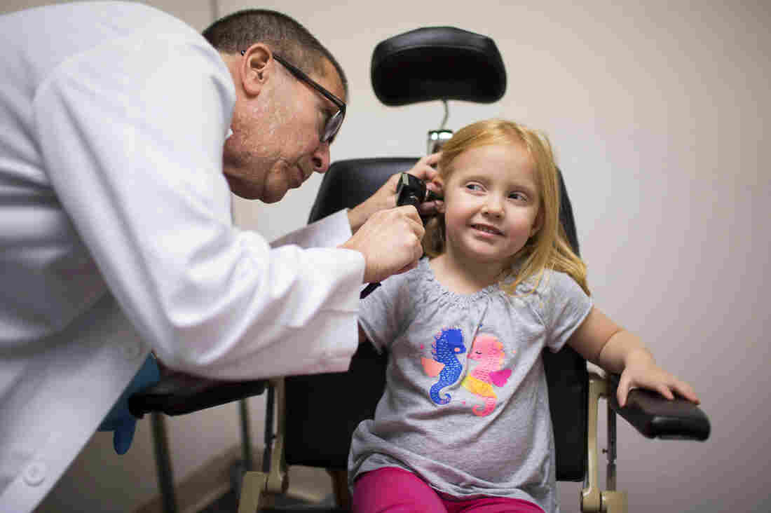 Dr. Max Lebow examines the ear of 4-year-old Charlotte Anderson at Reliant Immediate Care in Los Angeles. Charlotte's mom brought her to the urgent care clinic because Charlotte was having balance problems.