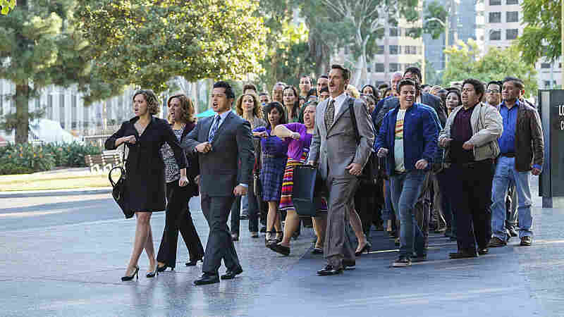 Rebecca Bunch (Rachel Bloom, far left) moves from New York to California in pursuit of her ex (Vincent Rodriguez III, third from left) in the CW's Crazy Ex-Girlfriend. (Also pictured: Donna Lynne Champlin, Pete Gardner and David Hull)