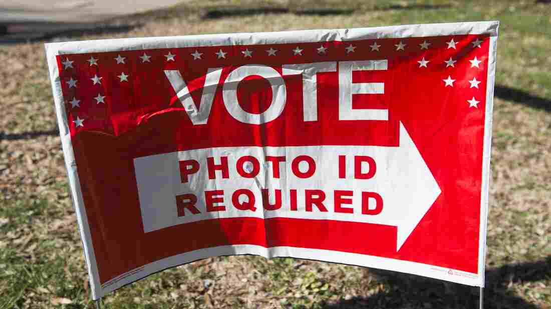 A sign directs voters to a polling place during the Super Tuesday primary voting at a polling place in Arlington, Va.