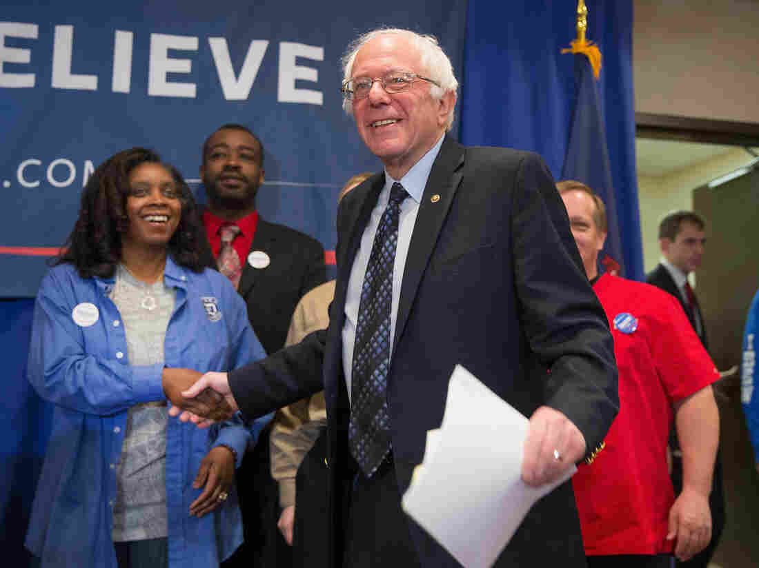 Bernie Sanders arrives for a press conference with union workers in East Lansing, Michigan, where he discussed the effect of free trade agreements on American workers.