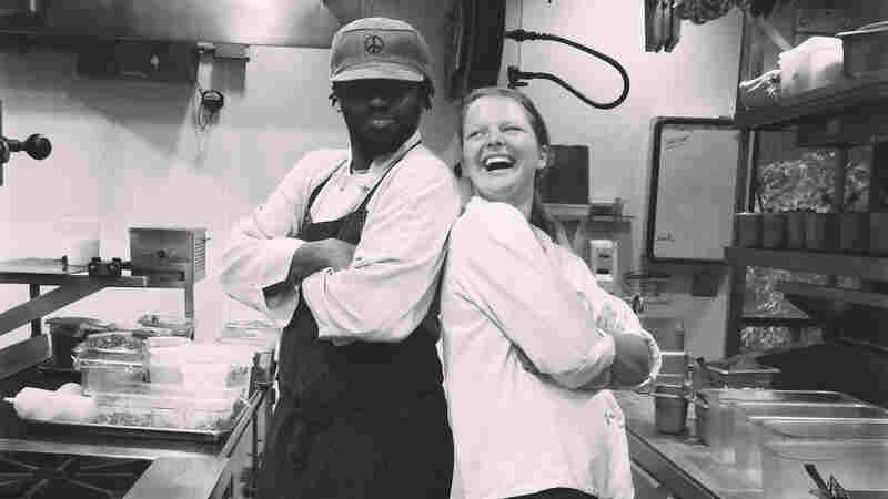 The writer, Rachael Cusick, is pictured with chef Oneil Wilson, her co-worker in the kitchen during a summer job as a line cook, during the breakfast shift.