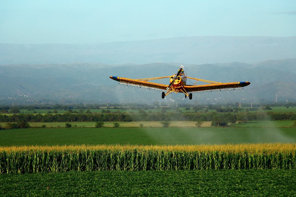 A crop duster sprays a field with pesticides. Former USDA scientist Jonathan Lundgren says that he has been persecuted by the agency because his research points out problems with popular pesticides.