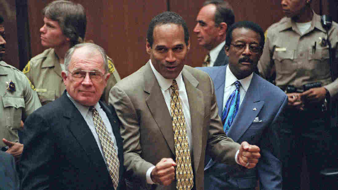 O.J. Simpson, flanked by defense attorneys F. Lee Bailey (left) and Johnnie Cochran Jr., reacts as he is found not guilty on Oct. 3, 1995, of murdering his ex-wife Nicole Brown Simpson and her friend Ron Goldman.