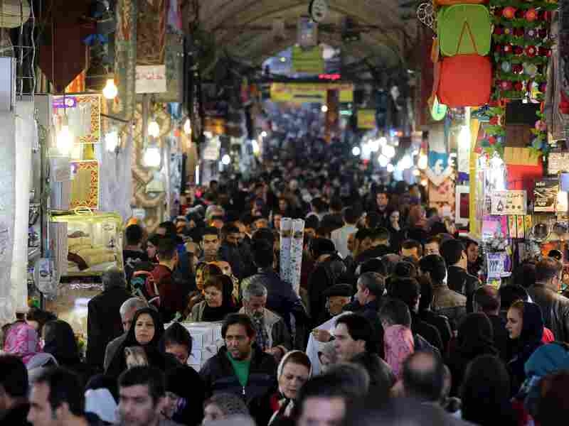 """Iranians shop in Tehran's ancient Grand Bazaar on Jan. 16, 2016, the day many sanctions were lifted as part of a nuclear deal. President Rouhani called the deal a """"golden page"""" in Iran's history."""