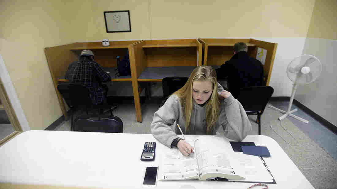 Rachel Barr, 17, of Scarborough, Maine, takes a practice SAT Test in a room with other students on February 23, 2016. The redesigned SAT is being administered to high school students for the first time Saturday.
