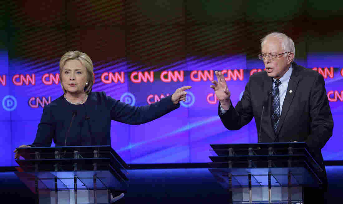 Hillary Clinton and Sen. Bernie Sanders square off during a Democratic presidential primary debate at the University of Michigan, Flint on Sunday.