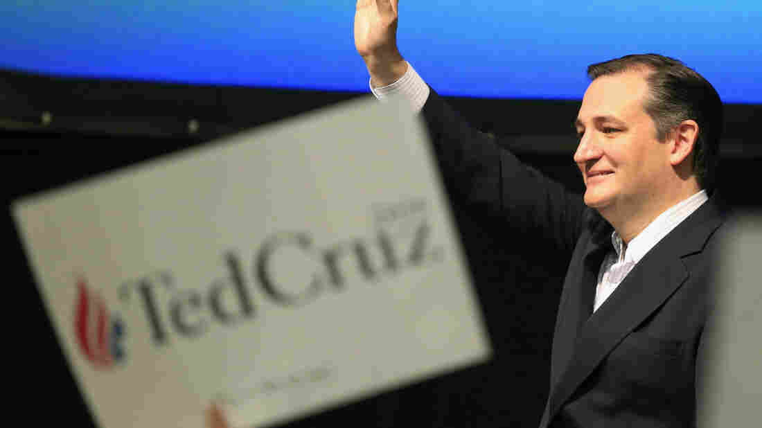 Republican presidential candidate, Sen. Ted Cruz, R-Texas waves to the crowd at the GOP caucus in Wichita, Kan., on Saturday.