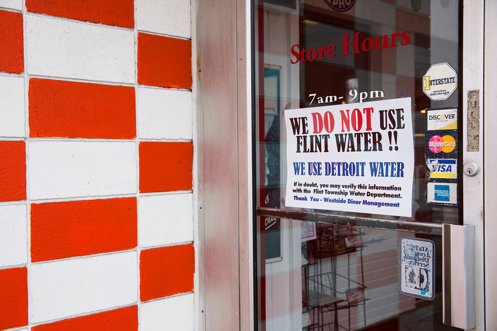 A sign at the Westside Diner in Flint, Mich., reassures customers that it serves uncontaminated water pulled from Detroit's drinking supply.