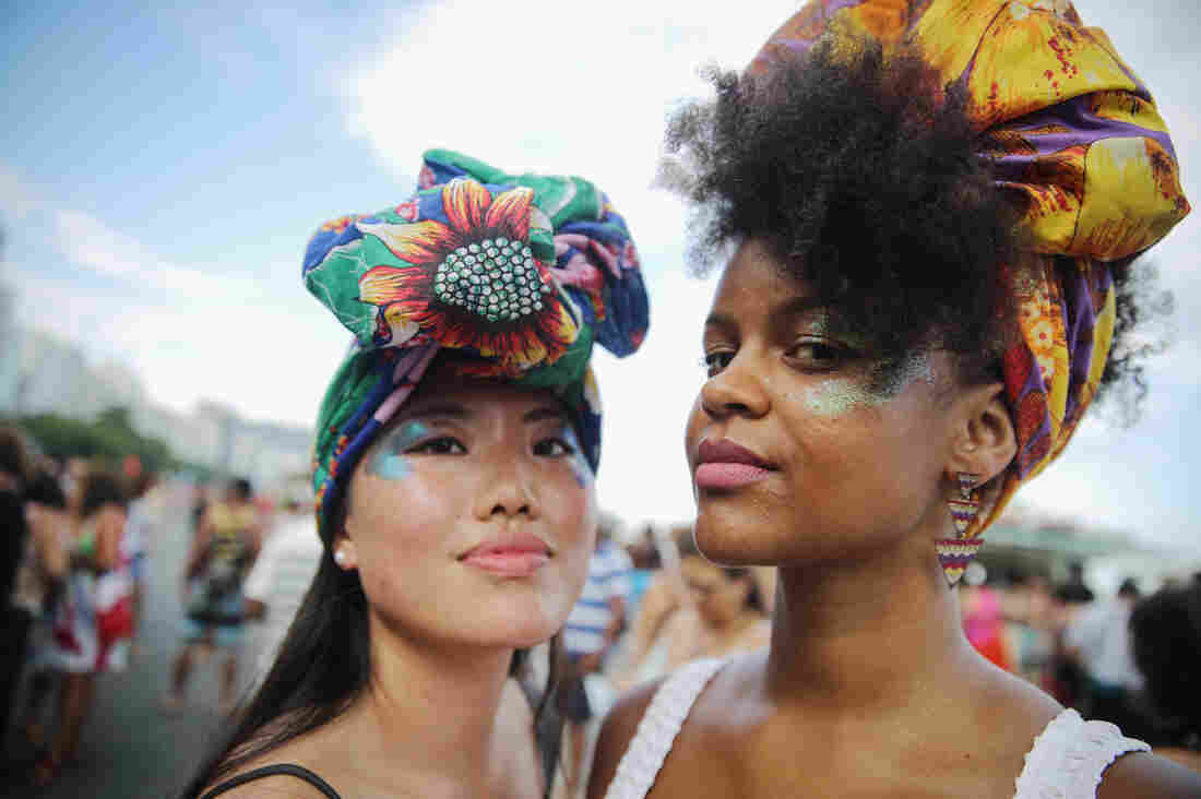 Women strike a pose during an International Women's Day march last year in Rio de Janeiro.
