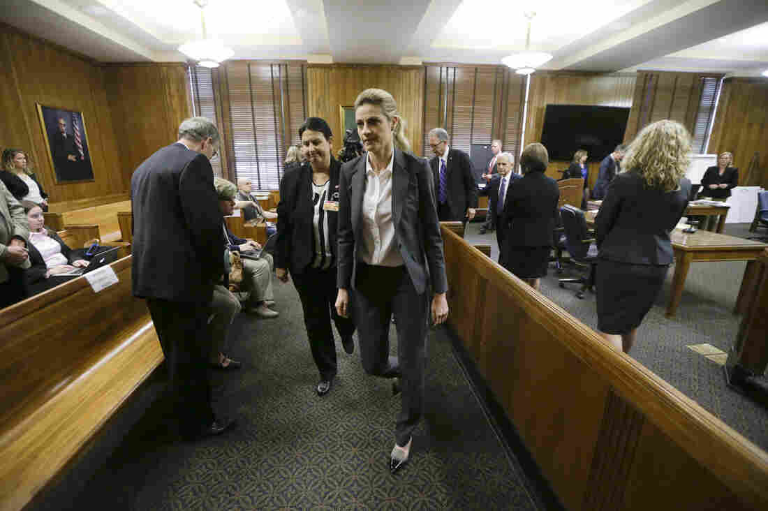 Fox Sportscaster Erin Andrews, who also hosts ABC's Dancing with the Stars (center), in court March 4. She sued a hotel after another guest secretly filmed her nude through a hotel door peephole.